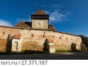 Купить «Image of Church Fortification in Axente Sever», фото № 27371187, снято 17 сентября 2017 г. (c) Яков Филимонов / Фотобанк Лори