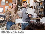 Купить «Satisfied couple demonstrating their buies in shop», фото № 27371267, снято 9 ноября 2017 г. (c) Яков Филимонов / Фотобанк Лори