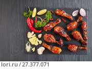 Купить «grilled crispy juicy teriyaki chicken drumsticks», фото № 27377071, снято 5 января 2018 г. (c) Oksana Zh / Фотобанк Лори