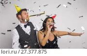 Купить «happy couple with party blowers having fun», видеоролик № 27377875, снято 26 декабря 2017 г. (c) Syda Productions / Фотобанк Лори