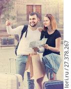 Купить «Couple of happy tourists with map and baggage», фото № 27378267, снято 25 мая 2017 г. (c) Яков Филимонов / Фотобанк Лори