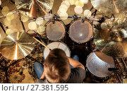 Купить «musician or drummer playing drum kit at studio», фото № 27381595, снято 18 августа 2016 г. (c) Syda Productions / Фотобанк Лори