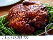 Купить «close up of roast chicken with green beans», фото № 27381735, снято 5 октября 2017 г. (c) Syda Productions / Фотобанк Лори
