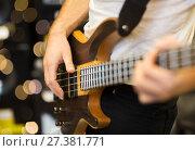 Купить «close up of musician with guitar at music studio», фото № 27381771, снято 11 декабря 2014 г. (c) Syda Productions / Фотобанк Лори