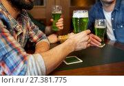 Купить «male friends drinking green beer at bar or pub», фото № 27381775, снято 22 апреля 2015 г. (c) Syda Productions / Фотобанк Лори