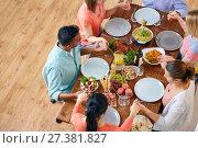 Купить «group of people at table praying before meal», фото № 27381827, снято 5 октября 2017 г. (c) Syda Productions / Фотобанк Лори