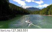 Two men sailing in the boat on a sunny day 4K 4k. Стоковое видео, агентство Wavebreak Media / Фотобанк Лори