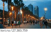 Купить «BARCELONA, SPAIN - AUGUST 27, 2017: View of Barceloneta beach with Mapfre tower and Arts Hotel in Barcelona in sunset», видеоролик № 27383759, снято 27 августа 2017 г. (c) Яков Филимонов / Фотобанк Лори