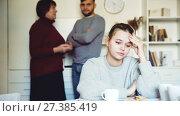 Купить «Portrait of young upset woman during quarrel with husband and his mother», видеоролик № 27385419, снято 21 декабря 2017 г. (c) Яков Филимонов / Фотобанк Лори