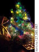Купить «Bag with gifts. Christmas candy and jack under the Christmas tree», фото № 27385987, снято 19 января 2016 г. (c) Евгений Ткачёв / Фотобанк Лори