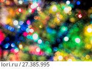 Купить «Abstract festive background with bokeh effect. Christmas tree and garlands of bright», фото № 27385995, снято 19 января 2016 г. (c) Евгений Ткачёв / Фотобанк Лори