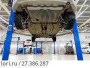 Купить «The car on the lift. Change engine oil and transmission inspection», фото № 27386287, снято 7 февраля 2016 г. (c) Евгений Ткачёв / Фотобанк Лори