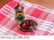 Купить «Ottoman teacup with traditional arabic ornaments. Raspberry jam in a glass bowl», фото № 27386319, снято 7 февраля 2016 г. (c) Евгений Ткачёв / Фотобанк Лори