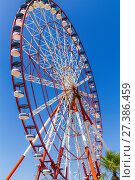 Купить «Ferris wheel on blue sky background», фото № 27386459, снято 10 июля 2013 г. (c) Евгений Ткачёв / Фотобанк Лори