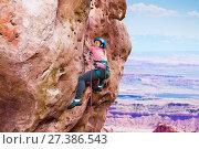 Купить «Girl rock climbing on summit of the mountain», фото № 27386543, снято 28 октября 2017 г. (c) Сергей Новиков / Фотобанк Лори