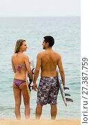 Купить «Young surfers couple on the beach», фото № 27387759, снято 20 января 2020 г. (c) Яков Филимонов / Фотобанк Лори