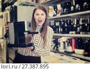 Купить «delighted young woman with purchase», фото № 27387895, снято 12 декабря 2017 г. (c) Яков Филимонов / Фотобанк Лори