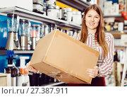 Купить «Portrait of pretty young woman with box», фото № 27387911, снято 12 декабря 2017 г. (c) Яков Филимонов / Фотобанк Лори