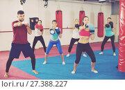 Купить «Group adult women are boxing with coach», фото № 27388227, снято 8 октября 2017 г. (c) Яков Филимонов / Фотобанк Лори