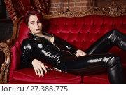 Купить «Beautiful fetish model in latex costume», фото № 27388775, снято 26 октября 2017 г. (c) Дмитрий Черевко / Фотобанк Лори