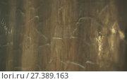 Купить «Artificial waterfall on the background of stone wall stock footage video», видеоролик № 27389163, снято 14 января 2018 г. (c) Юлия Машкова / Фотобанк Лори