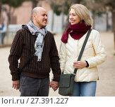 Купить «Couple relaxing during city walk», фото № 27391227, снято 18 октября 2018 г. (c) Яков Филимонов / Фотобанк Лори