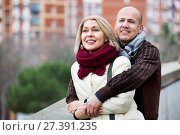 Portrait of pleasant smiling mature couple in city. Стоковое фото, фотограф Яков Филимонов / Фотобанк Лори