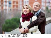 Купить «Portrait of pleasant smiling mature couple in city», фото № 27391235, снято 18 июля 2018 г. (c) Яков Филимонов / Фотобанк Лори