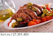 Купить «Grilled sausages and vegetables», фото № 27391483, снято 21 сентября 2018 г. (c) Яков Филимонов / Фотобанк Лори
