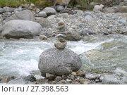 Купить «Пирамида из камней на берегу горной реки», фото № 27398563, снято 11 июля 2017 г. (c) Геннадий Соловьев / Фотобанк Лори