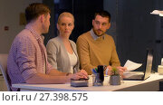 Купить «business team with laptop working at night office», видеоролик № 27398575, снято 14 декабря 2017 г. (c) Syda Productions / Фотобанк Лори