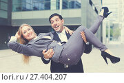 Купить «Boss is carry woman manager on hands because they are satisfied of successful contract», фото № 27404207, снято 20 августа 2017 г. (c) Яков Филимонов / Фотобанк Лори