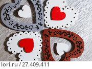 Купить «День святого Валентина, свадьба, любовь. Белые ажурные, красные, серые, коричневые, яркие деревянные сердца на серебристом сером фоне для поздравления или приглашения. Valentine's Day, wedding, love. White tracery, red, gray, brown, bright wooden hearts on a silvery gray background for congratulations or invitations.», фото № 27409411, снято 13 января 2018 г. (c) Светлана Евграфова / Фотобанк Лори