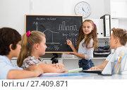 Купить «Girl discussing about mathematical formulas», фото № 27409871, снято 12 октября 2017 г. (c) Яков Филимонов / Фотобанк Лори