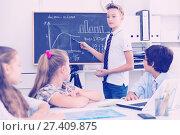 Купить «Teens male about mathematical formulas», фото № 27409875, снято 12 октября 2017 г. (c) Яков Филимонов / Фотобанк Лори