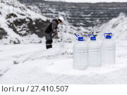 Купить «Man in special clothes collecting samples of water potentially contaminated by toxic material, in winter on the lake, in coal mine», фото № 27410507, снято 22 декабря 2017 г. (c) Сергей Тимофеев / Фотобанк Лори