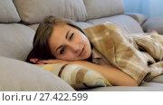 Купить «Young woman awaking on sofa in living room», видеоролик № 27422599, снято 2 июля 2017 г. (c) Яков Филимонов / Фотобанк Лори