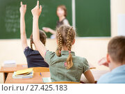 Купить «School children in classroom at lesson», фото № 27425183, снято 8 апреля 2020 г. (c) Оксана Кузьмина / Фотобанк Лори