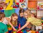 Купить «Children building blocks in kindergarten. Group kids playing toy floor .», фото № 27426419, снято 25 марта 2017 г. (c) Gennadiy Poznyakov / Фотобанк Лори