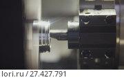 Купить «Replacing and placing the metal parts in the lathe for machining», фото № 27427791, снято 20 апреля 2018 г. (c) Константин Шишкин / Фотобанк Лори