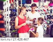 Купить «Family choosing shoes in sport shop», фото № 27428467, снято 24 января 2018 г. (c) Яков Филимонов / Фотобанк Лори
