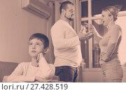 Купить «Upset son suffering from parents arguing», фото № 27428519, снято 12 ноября 2017 г. (c) Яков Филимонов / Фотобанк Лори