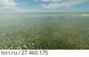 Купить «Aerial view of Bohol coast Island. Aerial. Flight is close above the water. Philippines.», видеоролик № 27460175, снято 20 января 2018 г. (c) Mikhail Davidovich / Фотобанк Лори