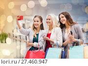 Купить «women with smartphones shopping and taking selfie», фото № 27460947, снято 3 ноября 2014 г. (c) Syda Productions / Фотобанк Лори