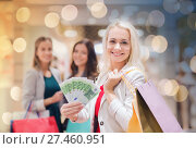 Купить «young women with shopping bags and money in mall», фото № 27460951, снято 3 ноября 2014 г. (c) Syda Productions / Фотобанк Лори