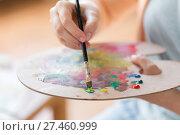 Купить «artist with palette and brush painting at studio», фото № 27460999, снято 1 июня 2017 г. (c) Syda Productions / Фотобанк Лори