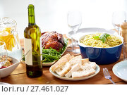 Купить «bottle of wine and food on served wooden table», фото № 27461027, снято 5 октября 2017 г. (c) Syda Productions / Фотобанк Лори