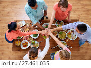 Купить «people holding hands together over table with food», фото № 27461035, снято 5 октября 2017 г. (c) Syda Productions / Фотобанк Лори