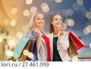 Купить «happy young women with shopping bags in mall», фото № 27461099, снято 3 ноября 2014 г. (c) Syda Productions / Фотобанк Лори