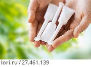 Купить «hand holding tubes of micro enema», фото № 27461139, снято 27 сентября 2017 г. (c) Syda Productions / Фотобанк Лори